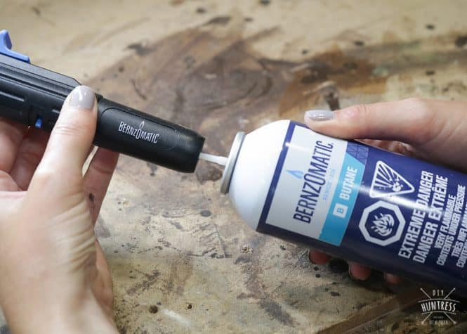 How to put butane in hand torch